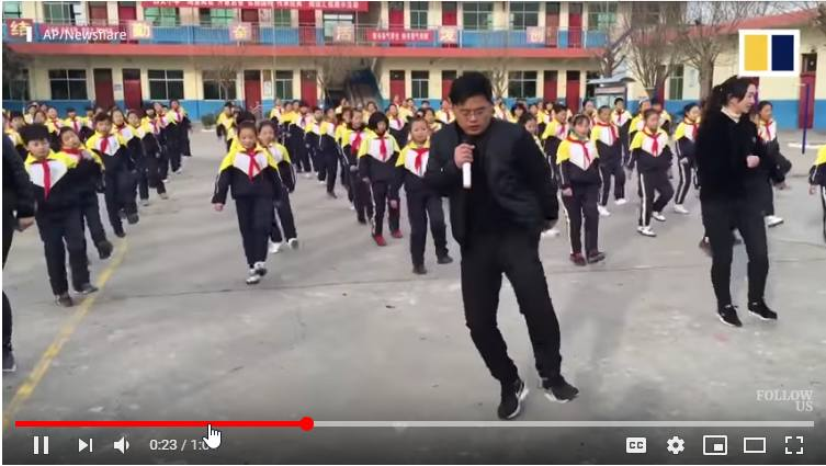 Video of a head teacher in China helping his students exercise using dance in the playground