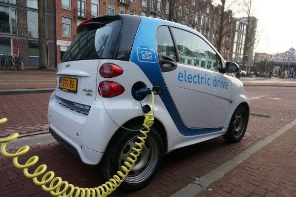 Electric car recharging on the street